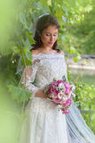 Bridal portrait in green foliage Royalty Free Stock Photos
