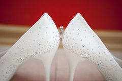 Bridal ring. And white shoes Stock Photos