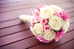 Bridal rose bouquet. Bridal bouquet of pink and wight roses on a wooden table surface Royalty Free Stock Photo