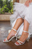 Bridal sandals. White sandals worn by bride royalty free stock photos