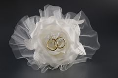 Bridal set. Wedding rings holder in the shape of rose flower stock photo