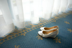 Bridal shoe. In front of window Stock Photos