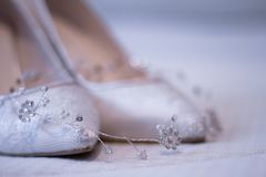 Bridal shoe with silver filigree stock photos