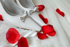 Bridal Shoes. With rose flowers royalty free stock image