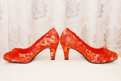 Bridal Shoes. Married bride wore red shoes Stock Photography