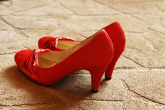 Bridal Shoes. Married bride wore red shoes Royalty Free Stock Photography