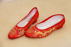 Bridal Shoes. Married bride wore red shoes Royalty Free Stock Photos