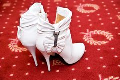 Bridal shoes. Bridal boots on the floor Royalty Free Stock Photography