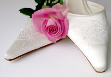 Bridal Shoes. Cream beaded bridal shoes for a wedding day with pretty pink rose Stock Photography