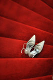 Bridal Shoes. White bridal shoes on red carpet Stock Photo
