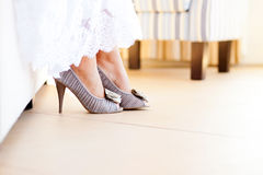 Bridal shoes. Closeup bridal dress and shoes Royalty Free Stock Photos