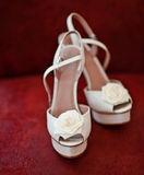 Bridal Shoes. On a red background Stock Photos