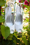 Bridal shoes. White bridal shoes on white background Stock Photo