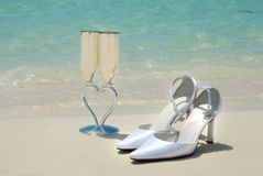 Bridal Shoes And Wedding Glasses Stock Photo