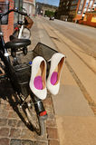 Bridal shoes on bicycle at street Stock Photos