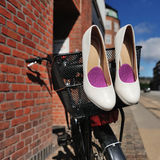 Bridal shoes on bicycle at street Stock Images