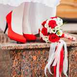 Bridal shoes and bouquet Royalty Free Stock Photo