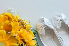 Bridal shoes  bouquet flowers Royalty Free Stock Images