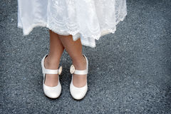 Bridal shoes. Close up of brides dress and shoes (crossed legs Royalty Free Stock Photos