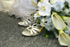 Bridal shoes detail. Wedding boquet and bride's shoes with vignetting Royalty Free Stock Photos