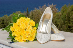 Bridal shoes and flower bouquet Stock Photography