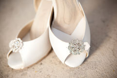 Bridal shoes in front of church Stock Photos