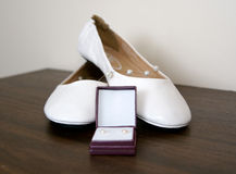 Bridal shoes and jewelry Stock Images