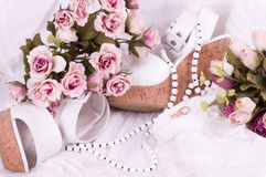 Bridal shoes, lace and wedding rings Stock Photos