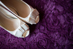 Bridal shoes. On purple background Stock Photos