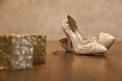 Bridal shoes and rings. stock photos