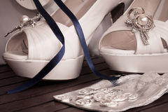 Bridal shoes and rings Stock Photo