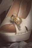 Bridal shoes and rings Stock Images