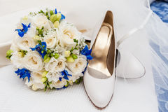 Bridal shoes, veil and wedding bouquet Stock Images