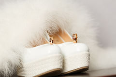 Bridal shoes with wedding rings and fur. Stock Images