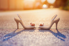 Bridal shoes and wedding rings Stock Photos