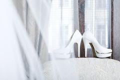 Bridal shoes. White shoes on the back seat Royalty Free Stock Photo