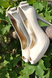 Bridal shoes. White wedding shoes hanging in the sun Stock Photography