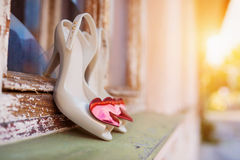 Bridal shoes on window parapet Royalty Free Stock Photos