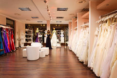 The bridal shop. Mannequins in wedding and evening gowns in the bridal shop Stock Photography