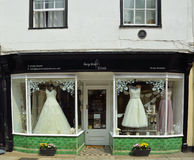 Bridal Shop Window with dresses on show. Stock Photo