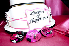 Bridal Shower Cake. With bridal party buttons on hot pink table cloth Royalty Free Stock Image