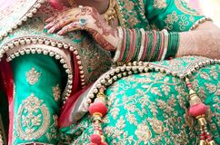 Bridal showing bangles and mehndi design. Pakistani bridal showing bangles and mehndi design, Indian bride showing colorful bangles stock photo