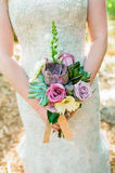 Bridal Succulent Bouquet. Shot on film, this bridal bouquet made of succulents is held in the hands of a bride on her wedding day Royalty Free Stock Photos