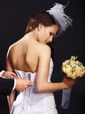 Bridal trying on wedding dress. Royalty Free Stock Photography