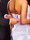 Bridal trying on wedding dress. Stock Image