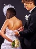 Bridal trying on wedding dress Stock Image