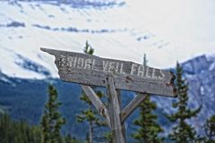 Bridal Veil Falls sign. Wooden sign pointing to Bridal Veil Water Falls in Alberta Canada Rocky Mountains Royalty Free Stock Images