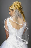 Bridal veil. Portrait of a young bride with high hair und white bride dress Royalty Free Stock Photography