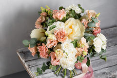 Bridal vintage bouquet. The bride`s . Beautiful of mixed flowers and greenery, decorated with silk ribbon, lies on Royalty Free Stock Photography