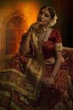 Bridal wear. Indian lady wearing bridal costume Royalty Free Stock Image